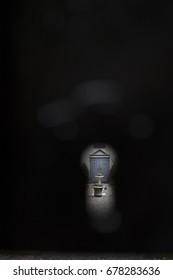 Cemetery through gate keyhole