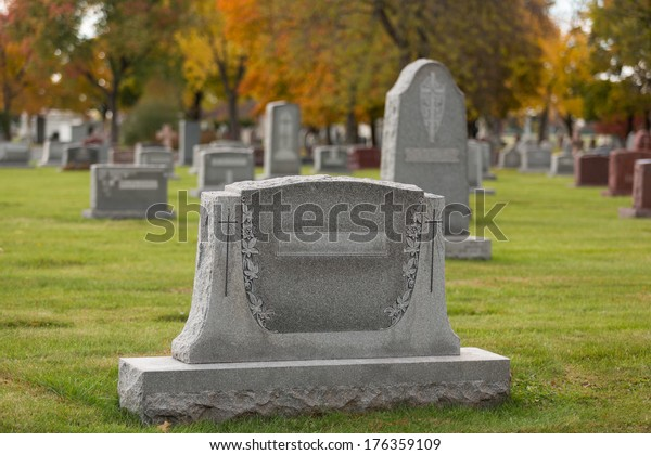 Cemetery Tombstone during fall season