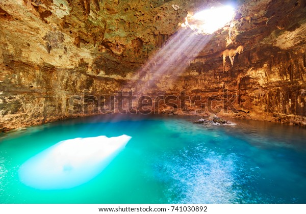 Cenote Samula sinkhole light beam near Valladolid in Yucatan Mexico