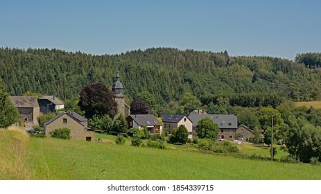 CENS, BELGIUM, AUGUST 6, 2020, Old little village with church, traditional houses and farms in Ardennes , Belgium. Cennes, 6 August 2020