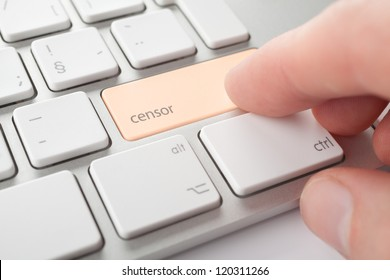 Censor press keypad on his keyboard. Internet censorship (expurgate, monitoring and control) threat concept.