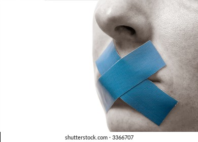 Censored Woman with blue tape on mouth. Colorkey, Face black-white. Isolated on white.