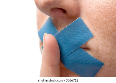 Censored Woman with blue tape on mouth. Finger before lips. Isolated on white.