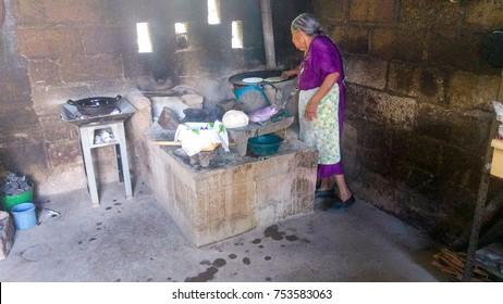 A centenarian great-grandmother makes handmade tortillas on a comal, in Guerrero, Mexico