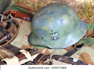 Centennial, CO, USA. June 7, 2014. Old Nazi helmet captured in Germany during World War 2 on display at World War 2 veterans appreciation Day in Centennial CO.