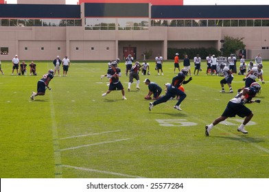 CENTENNIAL, COLORADO - JULY 26, 2008: Jay Cutler, Denver Broncos quarterback, prepares to pass on a practice play at Broncos camp on July 26, 2008.