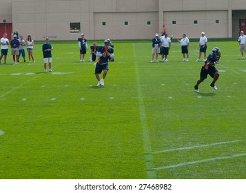 Centennial, COLORADO - JULY 26, 2008: The Denver Broncos Football team works out in summer camp lead by quarterback Jay Cutler on  July 26, 2008 in Centennial, Colorado.