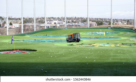 Centennial, Colorado - March 23, 2019: Golf driving range at Topgolf with ball-picker cart