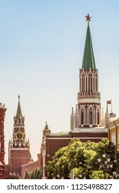 Center of the capital of Russia. Nikolskaya and Spasskaya towers in Moscow Kremlin on Red Square.