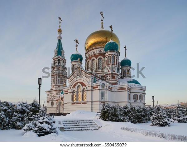 Center of the city of Omsk, Cathedral Square, the Holy Dormition Cathedral of the winter cold, snowy afternoon. Western Siberia Russia.
