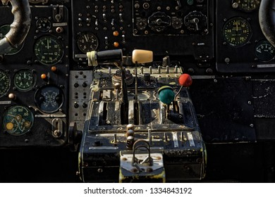 Center console and throttles in an old airplane closeup