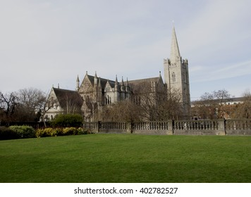 Center framed capture of the famous St. Patrick's Cathedral in Dublin. Clear blue sky and green grass.