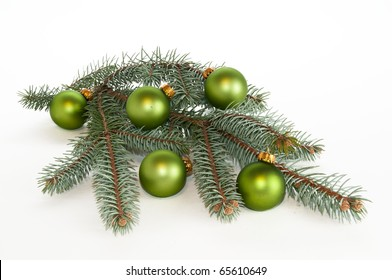 Center piece made of single branch of evergreen decorated with green ornaments on white, isolating background