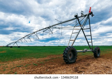 Center pivot irrigation system in cultivated wheat crop agricultural field