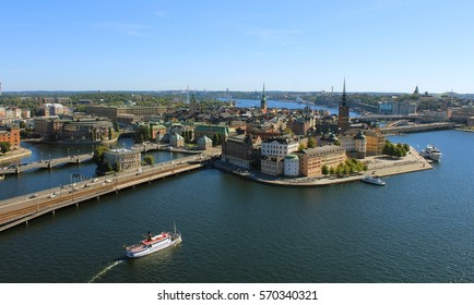 Center of Stockholm (with Gamla Stan) as seen from above from Stockholm Stadshus on a clear summer day during daytime with boat (Stockholm, Sweden, Europe)