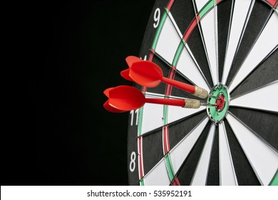 Center target of darts isolated on a black background