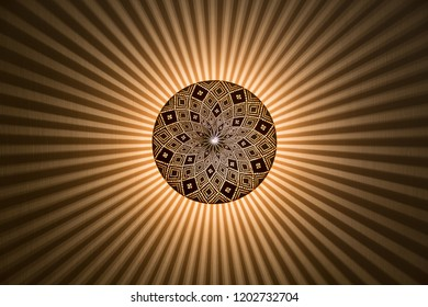 Centered ornate and round lamp with detailed pattern emitting stripes