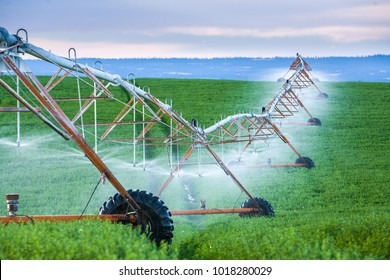 Center-pivot irrigation also called waterwheel and circle irrigation, is a method of crop irrigation in which equipment rotates around a pivot and crops are watered with sprinklers, Paulina, Oregon.