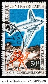 CENTRAL AFRICAN REPUBLIC - CIRCA 1972: a stamp printed in Central African Republic shows DC-3 and Mailman Riding Camel, circa 1972