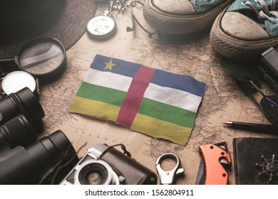 Central African Republic Flag Between Traveler's Accessories on Old Vintage Map. Tourist Destination Concept.