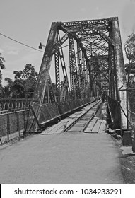Central American narrow gauge railway bridge for a long past railway and now used for foot traffic.  This type of bridge was prefabricated  in the USA and exported south in the early 20th Century