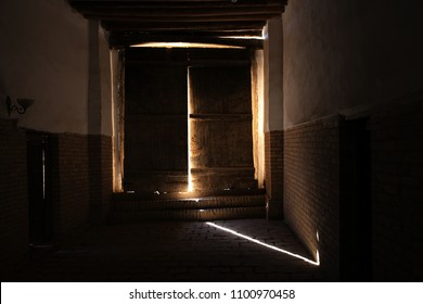Central Asia, Uzbekistan. An old door, a ray of sunshine, shadows and silhouettes. The old mysterious building.