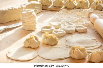 Central Asian traditional food. Preparation of the Uzbek dumplings - manti