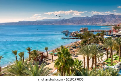 Central beach and marina in Eilat - famous resort and recreation city in Israel. This serene location is a very popular tropical getaway for Israeli and European tourists.