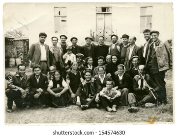 CENTRAL BULGARIA, BULGARIA,- CIRCA 1945: the area Plovdiv - Group of villagers (men, women and children) posing in a good mood. Note: slight blurriness, better at smaller sizes - circa 1945