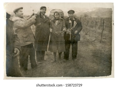 CENTRAL BULGARIA, BULGARIA - CIRCA 1955: the area Plovdiv - Vintage, men and women celebrate the grape harvest - Note: quite blurriness, better at smaller sizes - circa 1955