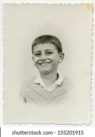 CENTRAL BULGARIA, BULGARIA - CIRCA 1955: Ordinary photo of an unknown laughing boy - Note: slight blurriness, better at smaller sizes - circa 1955