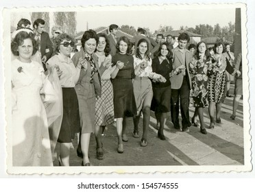 CENTRAL BULGARIA, BULGARIA,- CIRCA 1970: the area Plovdiv - Wedding celebration with dancing people (Choros dance - known in the Balkans).Note: slight blurriness, better at smaller sizes - circa 1970