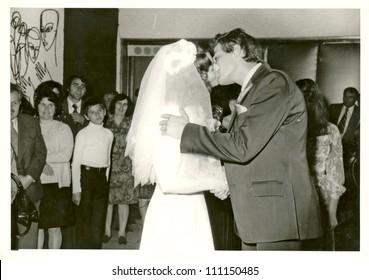 CENTRAL BULGARIA, BULGARIA,- CIRCA 1975: the area Plovdiv - newlyweds - the kiss - circa 1975