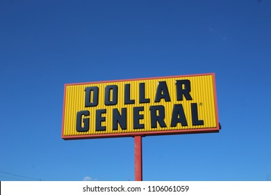 CENTRAL CITY ILLINOIS - MAY 2018: Dollar General sign against a blue sky in May 2018 in Central City, IL. The company operates variety stores in 45 states.