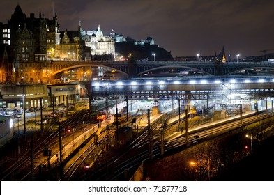 Central Edinburgh from Regent Road at night - vista including Waverley Train Station, North Bridge, Bank of Scotland building and Edinburgh Castle