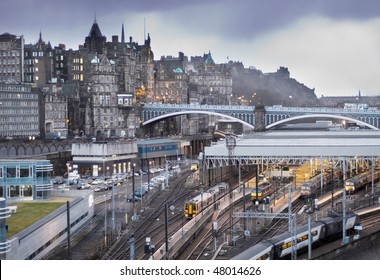Central Edinburgh, Scotland - landscape view of Waverley Station, North Bridge and Edinburgh Castle