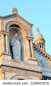 The central figure of Jesus Christ, a statue in an alcove on the Basilica Sacre Coeur (Basilica of the Sacred Heart) in early evening light at Montmartre, Paris, France