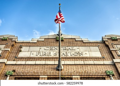 Central Fire Station American Flag in New Orleans LA USA outlined with a blue sky.  This building is over 100 years old.