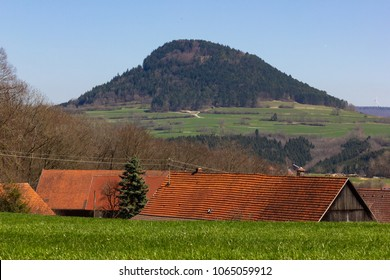Central German Uplands on easter springtime holiday with blue sky and green fields forest trees