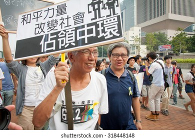 "Central Government Offices, Hong Kong - September 24, 2014: Third Day of 2014 Hong Kong class boycott campaign. The protester shows the sign of ""Occupy Central""."