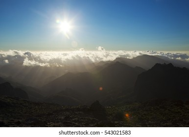 Central Gran Canaria in December, low evening light over the mountains, sun flare
