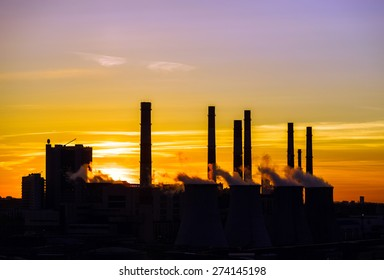 Central heating and power plant on beautiful colorful sunset background