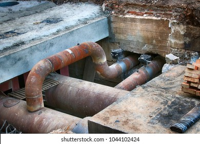 Central heating supply line under reconstruction in the summer city street
