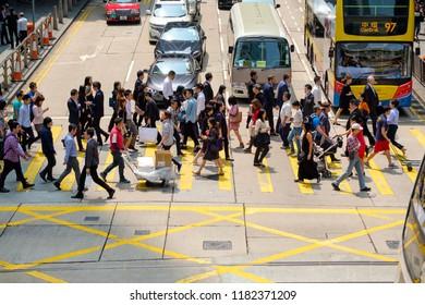 Central, Hong Kong, China - March 27 2018: Busy pedestrian crossing at  Hong Kong
