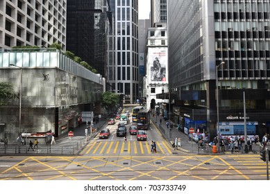 Central, Hong Kong - Dec 3 2016: Pedestrians, Buses And Traffic In Central Hong Kong