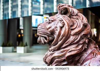 CENTRAL, HONG KONG - JAN 13, 2014 - One of the two bronze lion statue at the entrance to the HSBC Hong Kong headquarters. This lion is known as Sitt after former Shanghai manager G H Sitt.