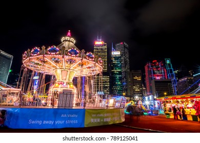 Central, Hong Kong  - January 04, 2018 :  People palying games in a large carnival in the heart of finanial center of Asia.