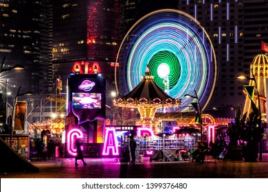 Central, Hong Kong  - January 08, 2019 :  People playing games in a large carnival in the heart of financial center of Asia.