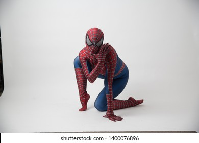 Central, Hong Kong - may 19, 2019: Man in superhero costume comic marvel spider on gray background