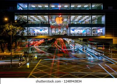 Central, Hong Kong  - November 30, 2018 : Red logo of Apple store of IFC mall of Hong Kong at night